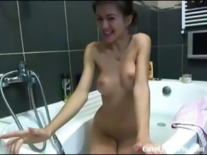 Sexy young brunette girlfriend sets up the camcorder and videos her steamy...