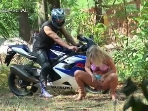 Hot blonde blows a cock in the forest