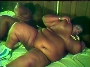 Fat black slut sucks off 2 white cocks
