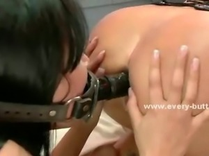 Brunette with big tits has her ass fucked with a clear dildo while wearing...