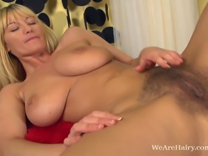 Vanessa J rubs her incredibly long legs up and down. She works up to her tits...