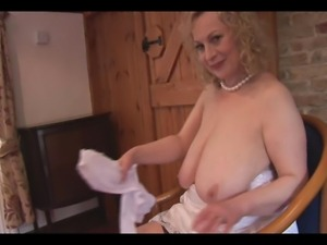 Huge boobs mature lady in slip and stockings strips and teases