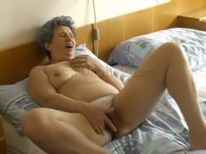 granny laying on the bed and masturbating