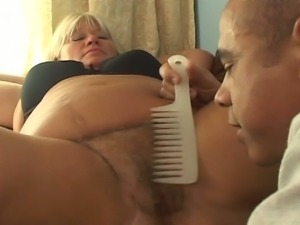 Bbw gets her hairy pussy combed.