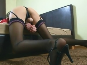 Blind strapon handjob and cum