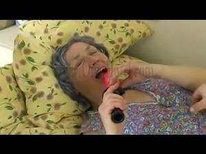 couple enjoys playing with their grandma