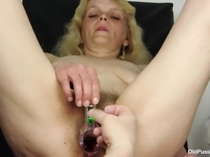 blonde mature slut pussy examined by a gynecologist