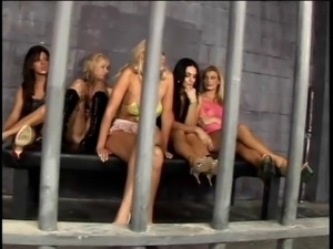 Five busty MILF hookers have wild lesbian action in prison