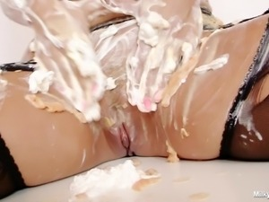 very hot and sexy blonde pleasing herself with milk cream
