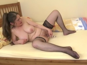brunette mature in stockings squeezing tits and playing dildo.