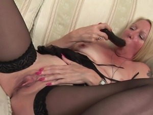 blonde mature has a big black dildo