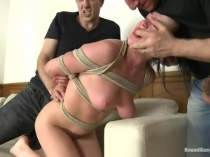 tied up brunette milf punished and gang banged