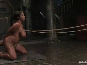 ebony milf is full of joy in a water bondage