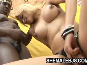 Horny shemale Giselle Lemos teasing a black cock until she gets cummed on her...