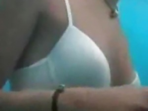 Super cute blonde caught changing into her bikini on hidden cam
