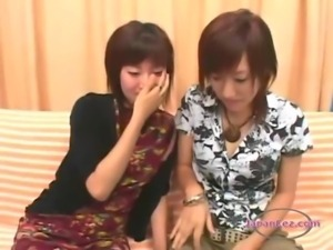 2 Asian Girls Kissing Sucking Tongues Rubbing Tits On The Couch And On The...