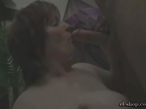 Mature European Redhead with big saggy tits wearing small bikini dances and...