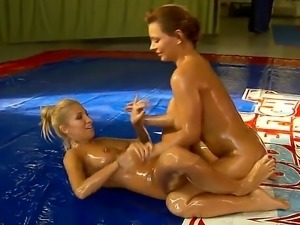 Blonde babes Dorothy Black and Clara gets oiled for a nude fight leading to a...