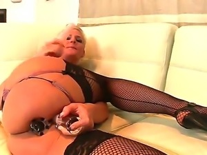 Horny golden haired Phoenix Marie sticks both of her dildos up her holes on...