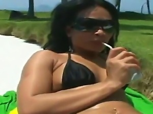 Quezia gets aroused by a sexy hunk Tony Tigrao on the beach and shows her...