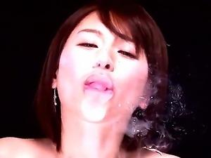Skinny Asian model Yuzuka Kinoshita poses in front of the camera playing with...