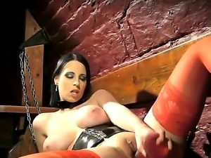 Busty prisoner Chrissie uses her lovely dildo to rub her beautiful shaved pussy