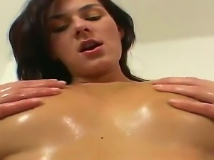 Young brunette Anita Quinn gets her oiled her big natural boobs and sexy butt
