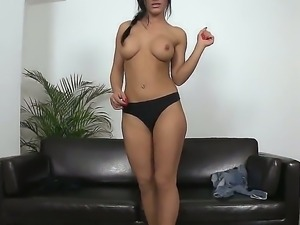 Brilliant brunette adores showing off her body and petting her pussy from out...