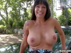 Angie Noir is a charming big titted milf from Europe!