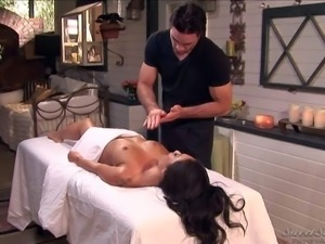 Dark haired Asa Akira enjoys in getting her body massaged,