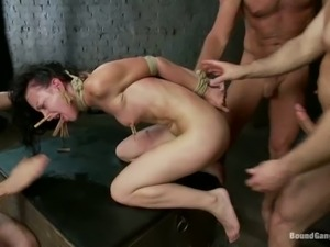 Dark haired slave girl Elise Graves is naked and helpless