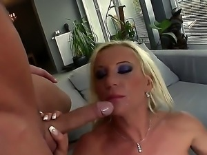 Bubble butt blonde babe Sharon gives two massive dicks a steamy blowie before...