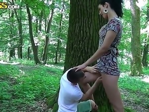 The amateur brunette Yasmine sucks to her boyfriend in the forest then he...