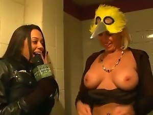 Some filthy and provocative sluts gets filmed as they flash thir juicy tits...