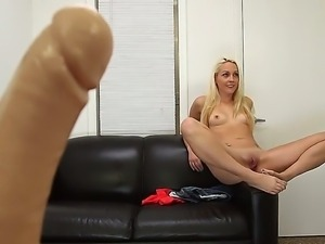 Young blonde Ashley Stone shoots her first solo porn scene right at her first...
