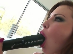 Kinky babe Katie gets a huge black dildo deep in her wet juicy muff after...