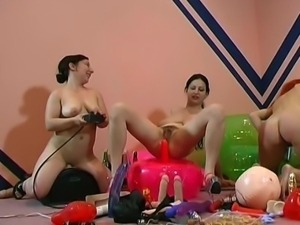Four lesbian sluts trying out some huge dildos and other sex toys
