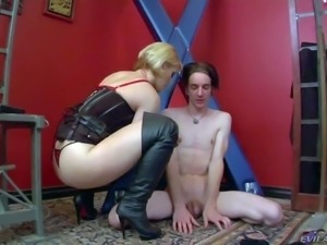Blonde haired mistress Ash Hollywood in high black leather boots