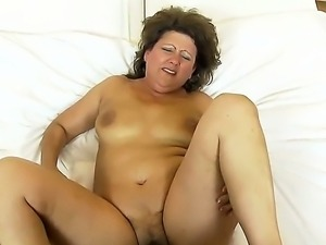 Mature horny granny Gigi plays with sex toys before getting rammed with a...