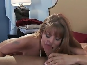 Danny Mountain is pleased to have sexy milf Darla Krane sucking his hard dick