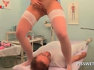 Hot blonde gets cunt examined by piss addict doctor