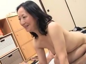 playing with her mature pussy