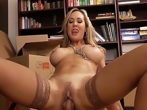 Hot and sexy blonde lady Brandi Love is sitting nude in her office chair with...