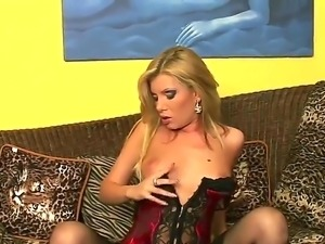 Cheep looking blonde bimbo Donna Bell with long whorish nails in corset and...