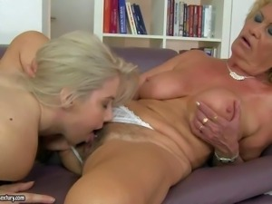 Aroused and young blonde babe Nesty enjoys in giving her mature lesbian lover...