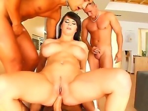 Busty babe named Kristi gets surrounded with cocks and she has to take care...