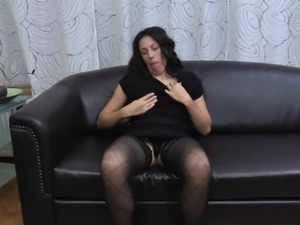mature woman masturbates on the couch