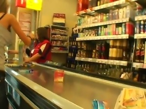 Slim blonde chick Nessa Devil strolls trhough a store while her lover is...
