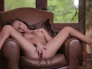 Victoria Lynn lies back, making her already perky natural tits rise, and...