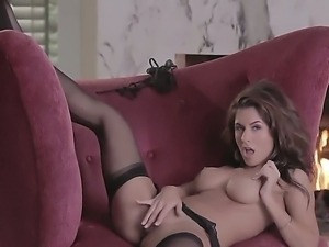 Danni Gee strips down to nothing -- save for her stockings -- and uses a big...
